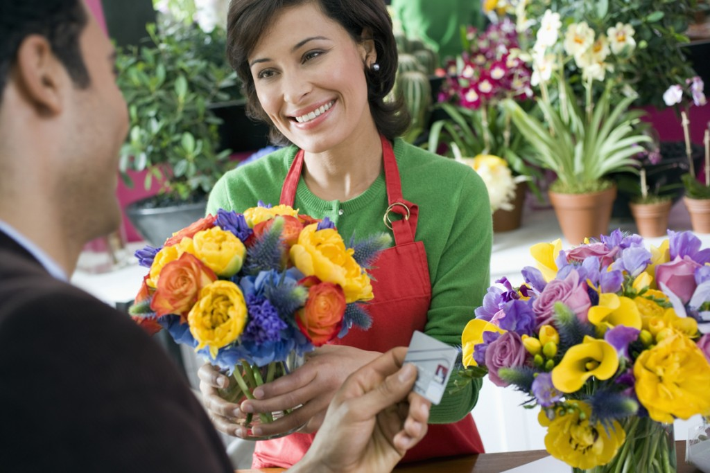 Florist Selling Bouquet to Man